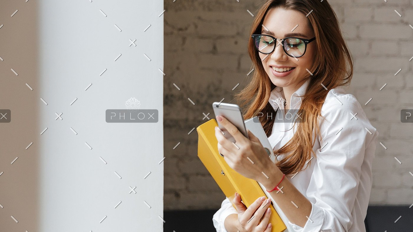 demo-attachment-175-happy-business-woman-indoors-using-mobile-phone-P9WS3SD